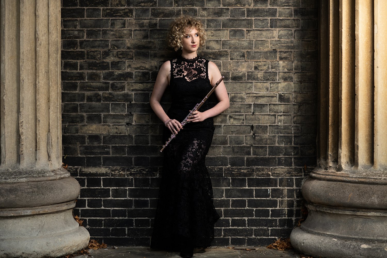 pillars-artsy-shot-black-bricks-church-flute-black-lace-concert-dress-woman-musician-mat-smith-photography.jpg